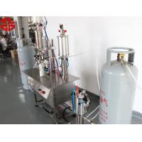Quality Refrigerant Under Cup Vacuum Aerosol Spray Filling Machine / Gas Filling Machine 100ml-1000ml for sale