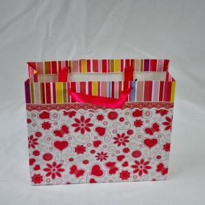 Quality Ribbon Handle Custom Paper Bags , Eco-friendly Flowery Kraft Paper Bag for sale