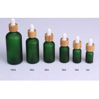 Quality frosted green glass cosmetic bottle 5ml 10ml 15ml 20ml 30ml 50ml 100ml cosmetic bamboo dropper bottle for sale