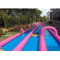 China Huge Commercial Inflatable Slip And Slide Double Lane In Pink on sale