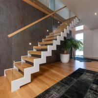 Quality Fordable lobby staircase in steel stringer glass handrail design for sale