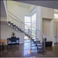 Quality Prefabricated steel curved staircase with tempered glass balustrade for sale