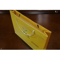 China Cloth Use Kraft Paper Gift Bags , Full Color Paper Shopping Bags with Handles on sale