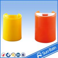 China Colorful red yellow standard disc cap for plastic shampoo bottles on sale