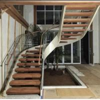 Quality Indoor use wood step glass railing steel curved staircase for sale
