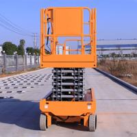 China Self Propelled Electric Scissor Lift 13.7m Orange For Large Working Place on sale