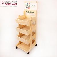 China Wooden Three Basket Mobile Portable Candy Floor Display Rack with Wheels on sale