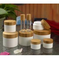 Buy 30ml 50ml 100ml 250ml plastic PP cosemtic jar with bamboo lid at wholesale prices
