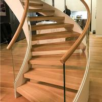 Quality New Style Curved Staircase Solid Wood Treads and Tempered Glass Railings for sale