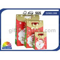 Quality Customized Christmas Gift Packaging Bag with Die Cut Handles Ribbon Bowknot for sale
