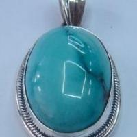 Quality Artisan crafted sterling, turquoise pendant basic wire design for sale
